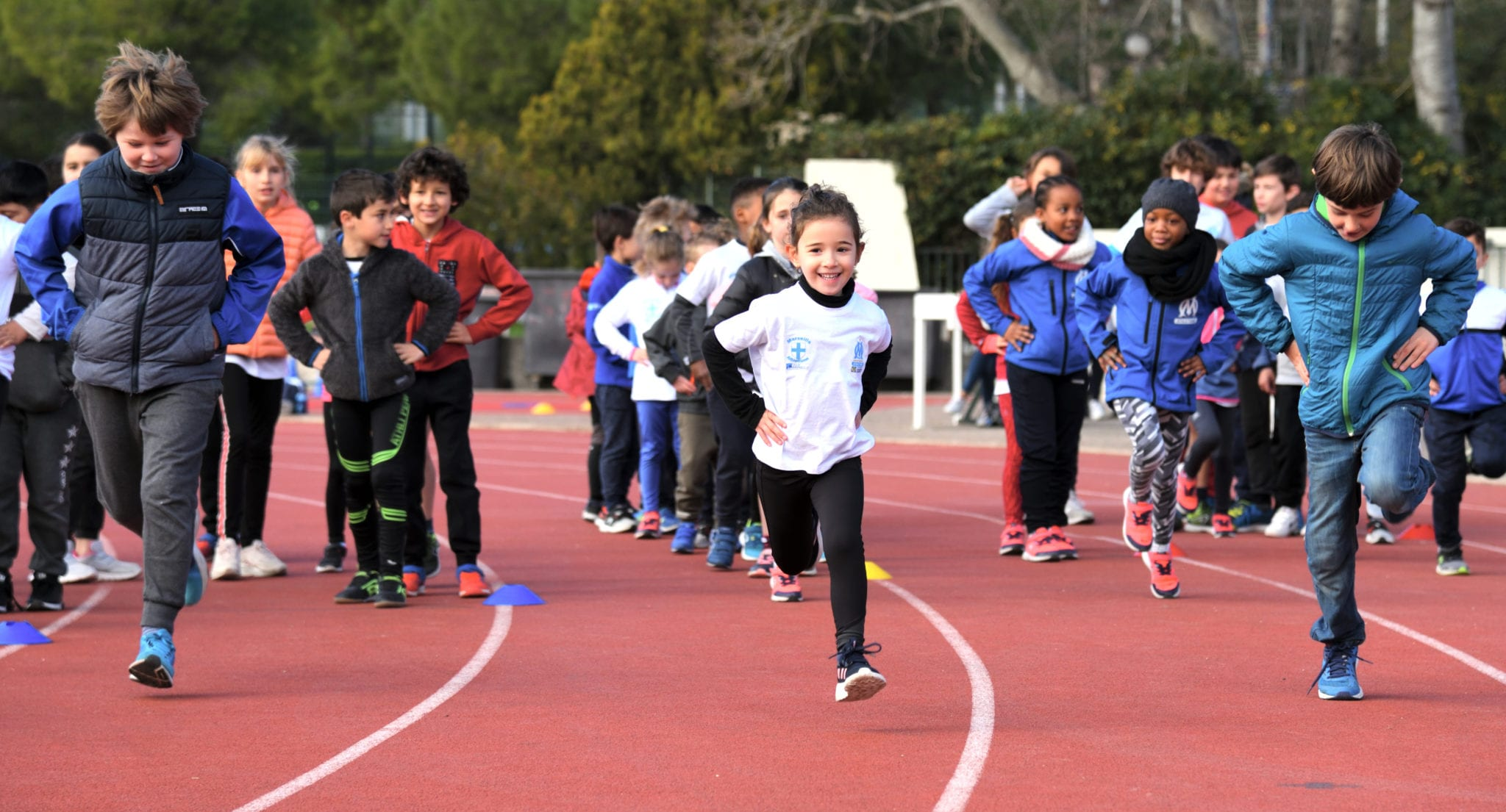 Ecole d'athletisme - enfants qui courrent